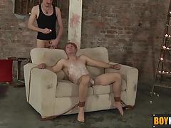 Kieron covers boy slave Jaxon in candle wax and cum