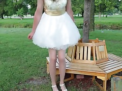 Crossdressing Princess sitting in the Park
