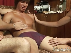 Two eager twink boys team up to pleasure one hunk