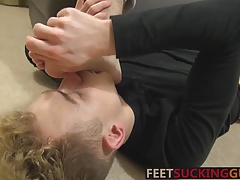 After licking his feet he lubes his ass and rides him hard