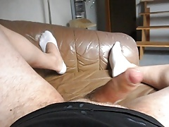 Twink masturbating on a couch