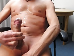 boy wanking and cumming on his breast and belly