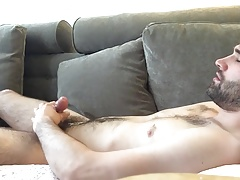 hairy guy comes 3 times on sofa