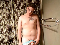 Shaved twink practices deepthroating in the shower