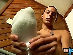 Jessie masturbates and covers his twink feet with fresh cum