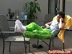 Slim homosexual Rodrigo shows his hairy feet outdoors
