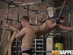 Koby Lewis steals some fresh hot cum from his bondage freind
