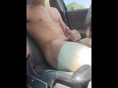 Young male masturbates in car